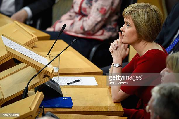 SNP leader Nicola Sturgeon is formally voted in as first minister of Scotland at the Scottish Parliament on November 19 2014 in Edinburgh Scotland Ms...