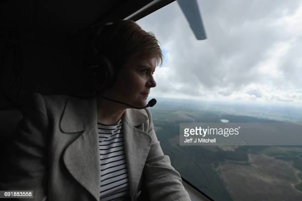 SNP leader Nicola Sturgeon looks out of the helicopter window while campaigning for the General Election on June 3 2017 in Dumfries Scotland As all...