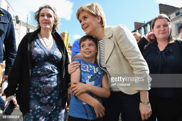 SNP leader Nicola Sturgeon meets a young supporter while campaigning for the General Election on June 3 2017 in Dumfries Scotland As all party's gear...