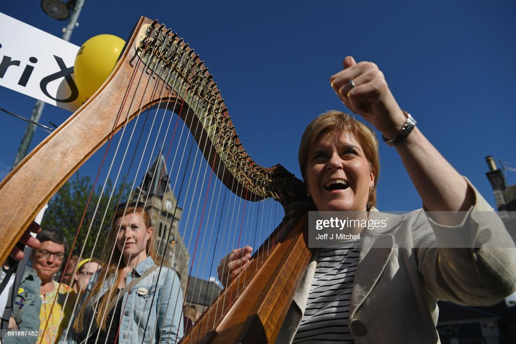 SNP leader Nicola Sturgeon plays the harp while campaigning for the General Election on June 3, 2017 in Biggar, Scotland. As all party's gear up for the final weekend's campaigning before next Thursday's General Election, the SNP leader has begun a tour of thirty constituencies across Scotland between now and polling day.