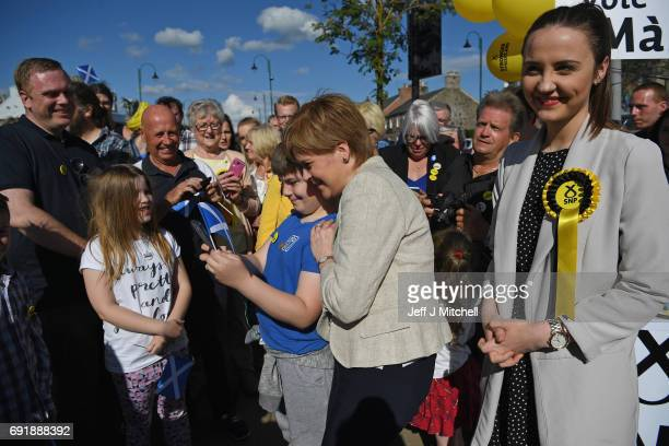 SNP leader Nicola Sturgeon poses for a selfie with a young supporter as local SNP candidate for Dumfriesshire Clydesdale and Tweeddale Mairi McAllan...