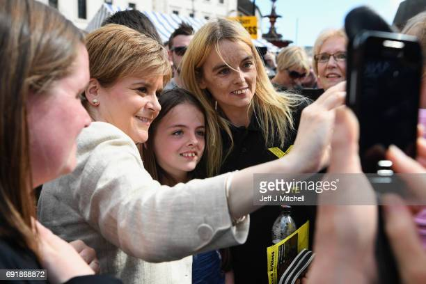 SNP leader Nicola Sturgeon poses for a selfie with supporters while campaigning for the General Election on June 3 2017 in Dumfries Scotland As all...