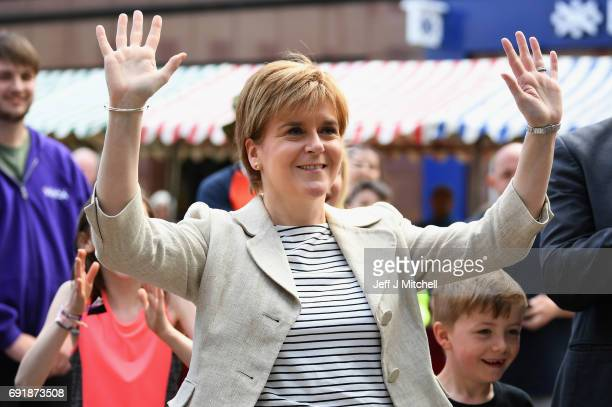 SNP leader Nicola Sturgeon reacts as she plays basketball while campaigning for the General Election on June 3 2017 in Dumfries Scotland As all...