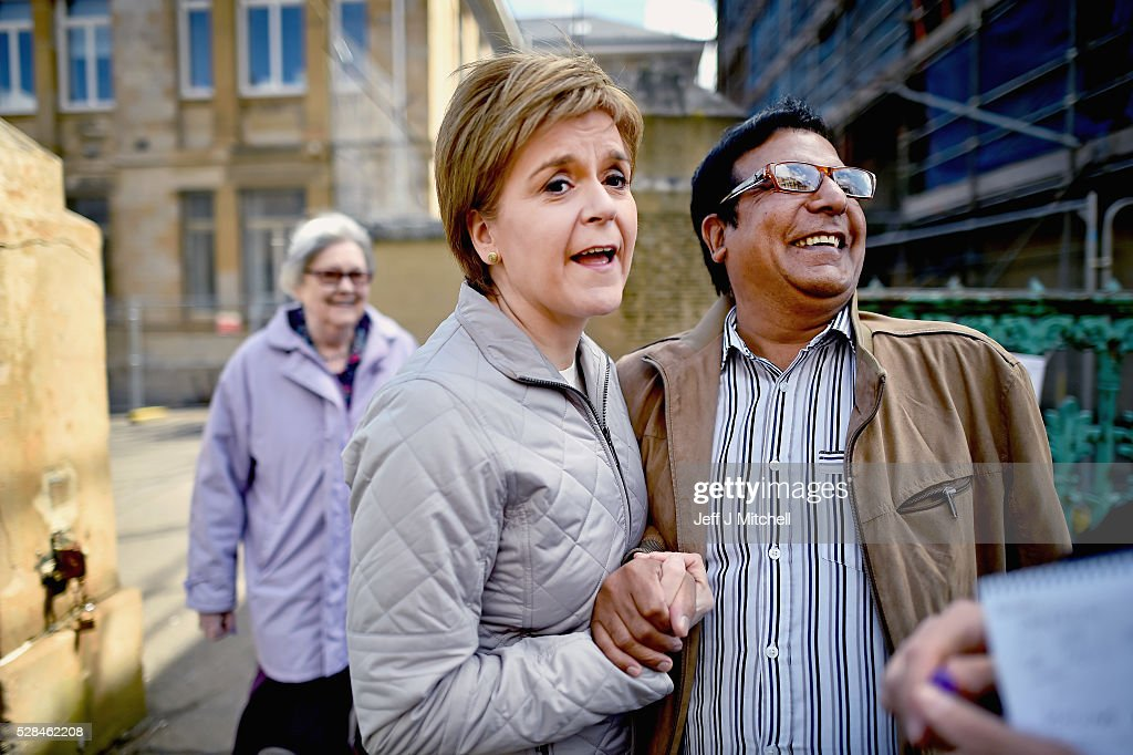 Leader <a gi-track='captionPersonalityLinkClicked' href=/galleries/search?phrase=Nicola+Sturgeon&family=editorial&specificpeople=2582617 ng-click='$event.stopPropagation()'>Nicola Sturgeon</a> returns to her constituency to meet voters on May 5, 2016 in Glasgow,Scotland. Today, dubbed 'Super Thursday', sees the British public vote in countrywide elections to choose members for the Scottish Parliament, the Welsh Assembly, the Northern Ireland Assembly, Local Councils, a new London Mayor and Police and Crime Commissioners. There are around 45 million registered voters in the UK and polling stations open from 7am until 10pm.