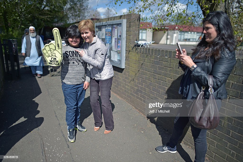 Leader Nicola Sturgeon returns to her constituency to meet voters on May 5, 2016 in Glasgow,Scotland. Today, dubbed 'Super Thursday', sees the British public vote in countrywide elections to choose members for the Scottish Parliament, the Welsh Assembly, the Northern Ireland Assembly, Local Councils, a new London Mayor and Police and Crime Commissioners. There are around 45 million registered voters in the UK and polling stations open from 7am until 10pm.