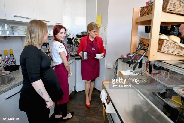 SNP leader Nicola Sturgeon serves a cup of coffee as she campaigns with the candidate for East Lothian George Kerevan on May 17 2017 in Mussleburgh...