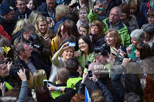 Leader Nicola Sturgeon takes a picture with activists in Buchanan Street SNP along with actor and campaigner Elaine C Smith to launch the SNP's...