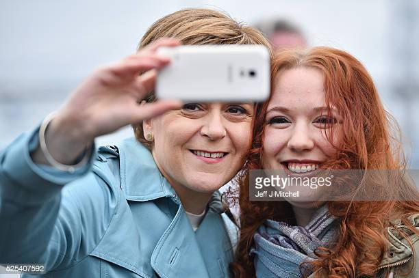 SNP leader Nicola Sturgeon takes a selfie with a young woman on April 28 2016 in South Queensferry Scotland SNP Leader and First Minister Nicola...