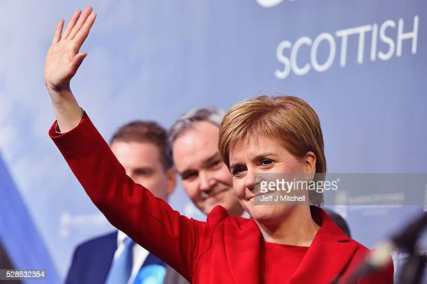 SNP leader Nicola Sturgeon waves after winning her seat Glasgow Southside in the Scottish Parliament elections at the Emirates Arena on May 5 2016 in...