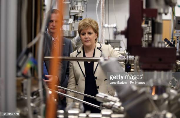 SNP leader Nicola Sturgeon with North East Fife candidate Stephen Gethins take a closer look at a Molecular Beam epitaxy machine in the Centre for...