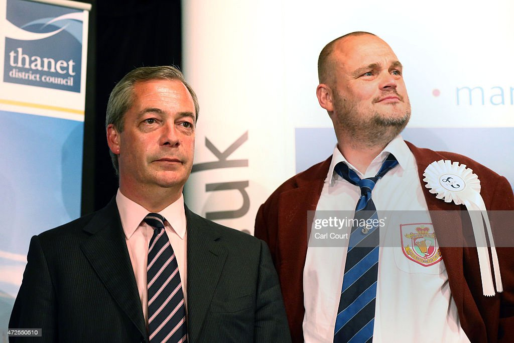 UKIP leader Nigel Farage and Alastair James Hay better known as comedian 'Al Murray' who portrays an English pub landlord look on as Conservative...