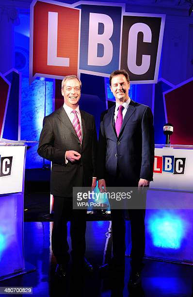 UKIP leader Nigel Farage and Deputy Prime Minister Nick Clegg pose for a picture as they take part in a debate over Britain's future in the European...