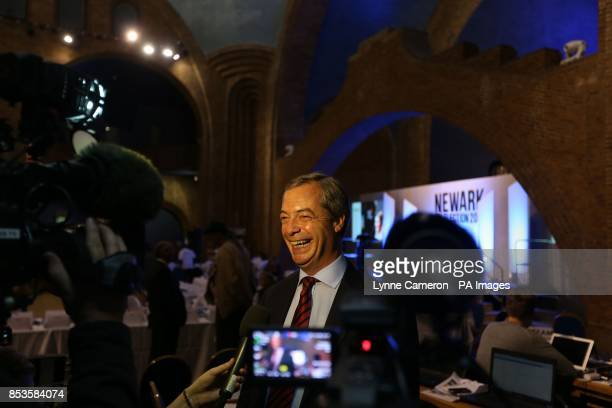 UKIP leader Nigel Farage conducts an interview during the Newark byelection count at Kelham Hall Newark