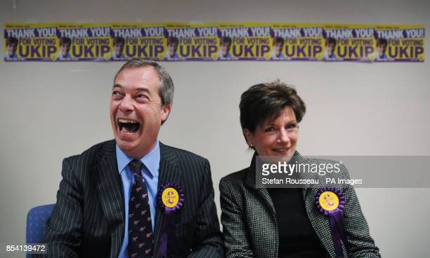 UKIP leader Nigel Farage congratulates their candidate Diane James on coming second in the Eastleigh byelection after holding a news conference in...