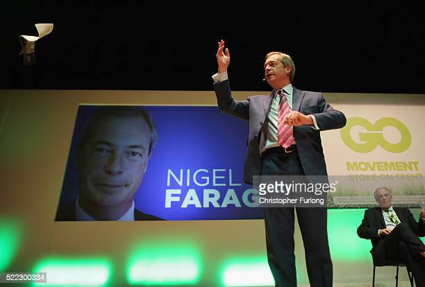 UKIP leader Nigel Farage discards the government's EU referendum information pamphlet a he addresses a Grassroots Out rally at Victoria Hall on April...