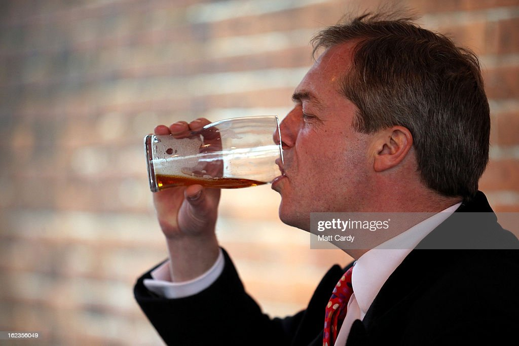 Leader <a gi-track='captionPersonalityLinkClicked' href=/galleries/search?phrase=Nigel+Farage&family=editorial&specificpeople=697991 ng-click='$event.stopPropagation()'>Nigel Farage</a> finishes his pint of beer as takes a break in a pub whilst he helps campaign for the forthcoming by-election on February 22, 2013 in Eastleigh, Hampshire. The by-election is being fought for the former seat of ex-Liberal Democrat MP Chris Huhne and will be held on February 28, 2013.