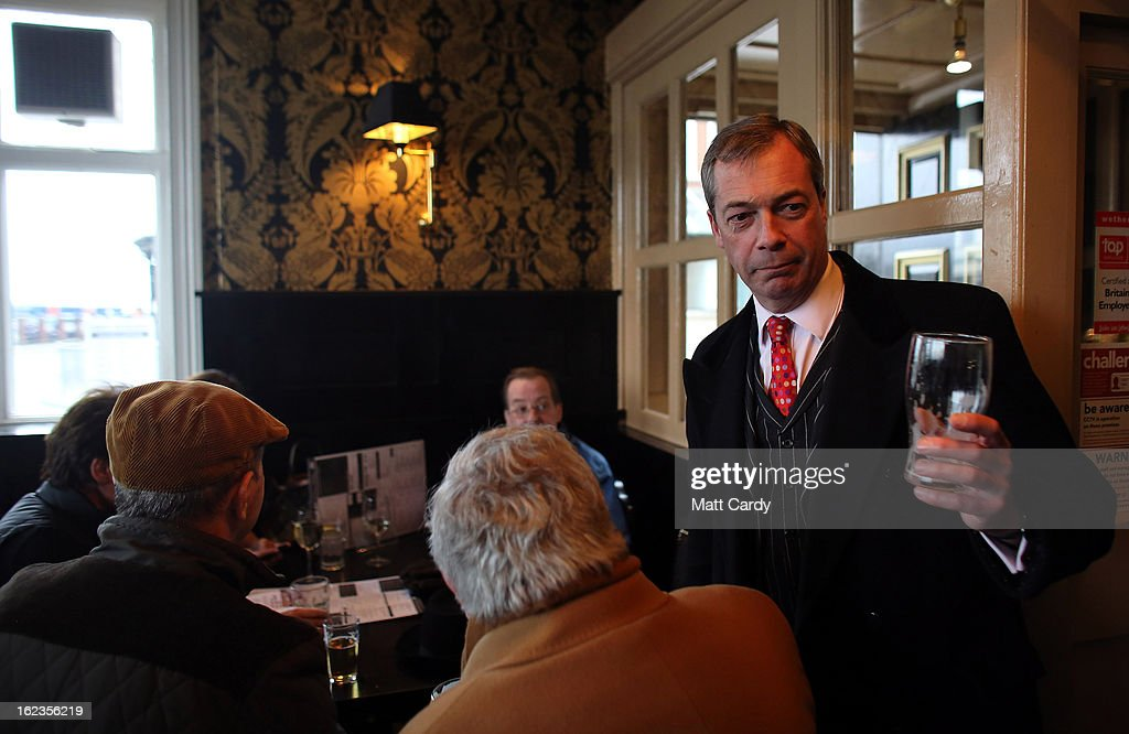Leader Nigel Farage goes to buy a round of drinks at the bar as takes a break in a pub whilst helping to campaign for the forthcoming by-election on February 22, 2013 in Eastleigh, Hampshire. The by-election is being fought for the former seat of ex-Liberal Democrat MP Chris Huhne and will be held on February 28, 2013.