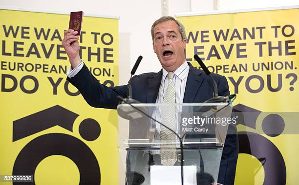 UKIP leader Nigel Farage holds up his British passport as he speaks at a Grassroots Out campaign rally at the Mercure Bristol Grand Hotel on June 4...