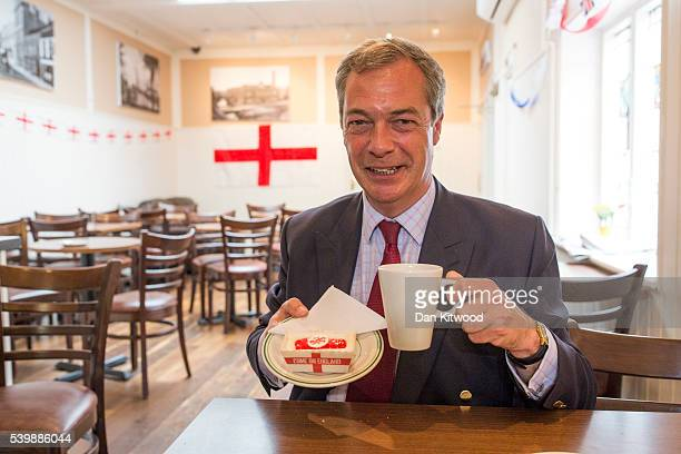 UKIP leader Nigel Farage poses with a cake in Barrow's Bakery on June 13 2016 in Sittingbourne England Mr Farage will be spending the day driving...