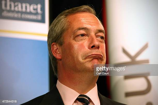 UKIP leader Nigel Farage reacts as Conservative Party candidate Craig Mackinlay is announced as the winner of the Thanet South constituency on May 8...