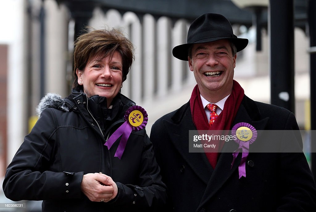 Leader Nigel Farage (R) shares a joke as he canvasses with the party's local candidate Diane James (L) whilst helping to campaign for the forthcoming by-election on February 22, 2013 in Eastleigh, Hampshire. The by-election is being fought for the former seat of ex-Liberal Democrat MP Chris Huhne and will be held on February 28, 2013.