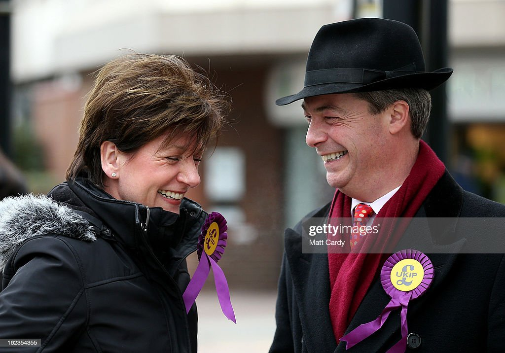 Leader <a gi-track='captionPersonalityLinkClicked' href=/galleries/search?phrase=Nigel+Farage&family=editorial&specificpeople=697991 ng-click='$event.stopPropagation()'>Nigel Farage</a> shares a jokes as he canvasses with the party's local candidate Diane James (L) as he helps her campaign for the forthcoming by-election on February 22, 2013 in Eastleigh, Hampshire. The by-election is being fought for the former seat of ex-Liberal Democrat MP Chris Huhne and will be held on February 28, 2013.