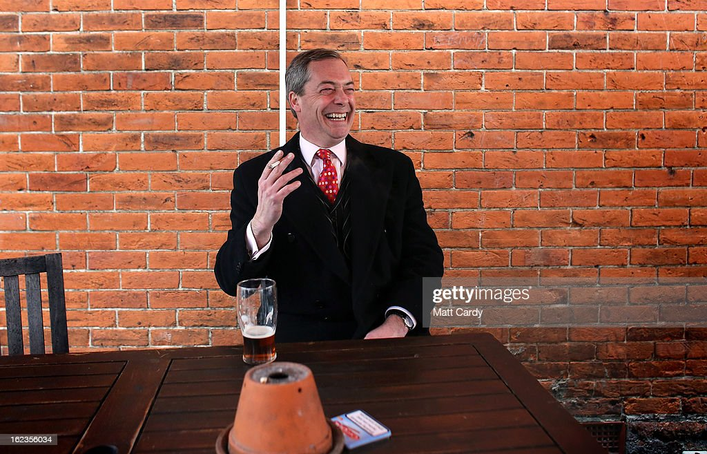 Leader Nigel Farage smokes a cigarette and drinks a pint of beer as takes a break in a pub as he helps campaign for the forthcoming by-election on February 22, 2013 in Eastleigh, Hampshire. The by-election is being fought for the former seat of ex-Liberal Democrat MP Chris Huhne and will be held on February 28, 2013.