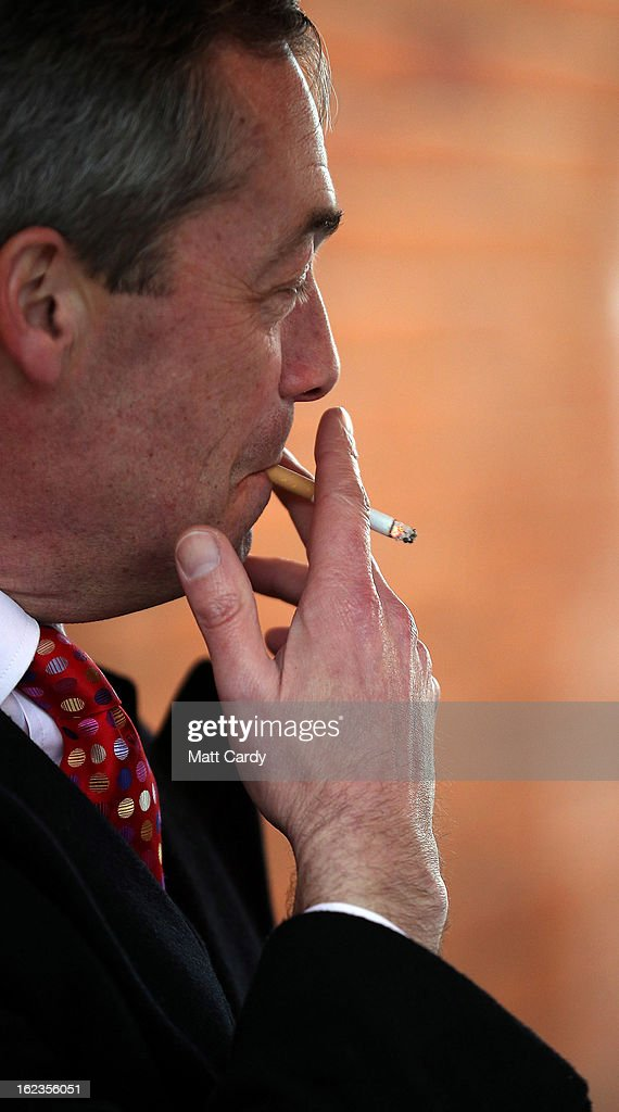 Leader <a gi-track='captionPersonalityLinkClicked' href=/galleries/search?phrase=Nigel+Farage&family=editorial&specificpeople=697991 ng-click='$event.stopPropagation()'>Nigel Farage</a> smokes a cigarette as takes a break in a pub whilst he helps campaign for the forthcoming by-election on February 22, 2013 in Eastleigh, Hampshire. The by-election is being fought for the former seat of ex-Liberal Democrat MP Chris Huhne and will be held on February 28, 2013.