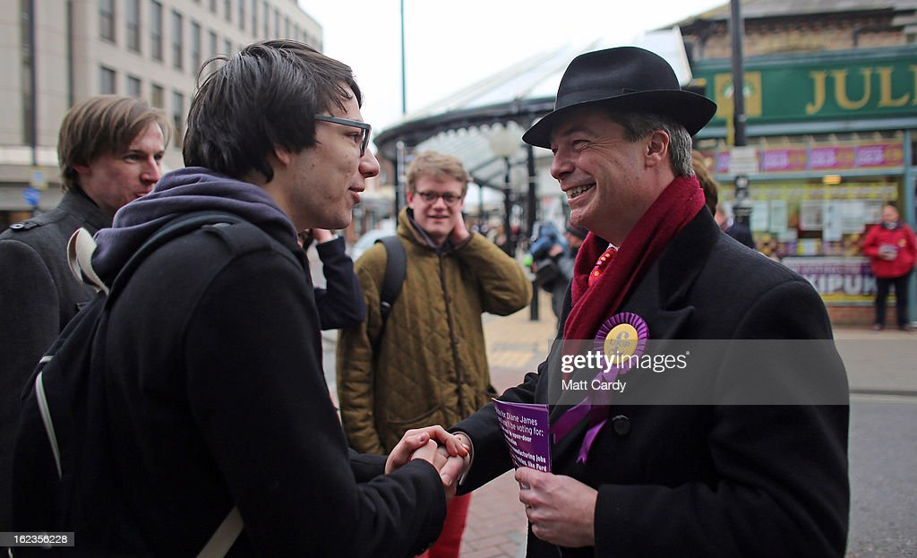 Leader Nigel Farage (R) speaks with voters as he helps campaign for the forthcoming by-election on February 22, 2013 in Eastleigh, Hampshire. The by-election is being fought for the former seat of ex-Liberal Democrat MP Chris Huhne and will be held on February 28, 2013.