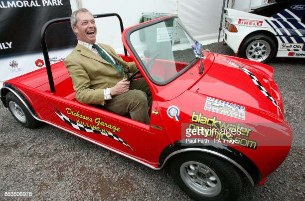 Leader Nigel Farage tries out a converted mini at the start of the annual Balmoral show outside Belfast during a one day visit to the province