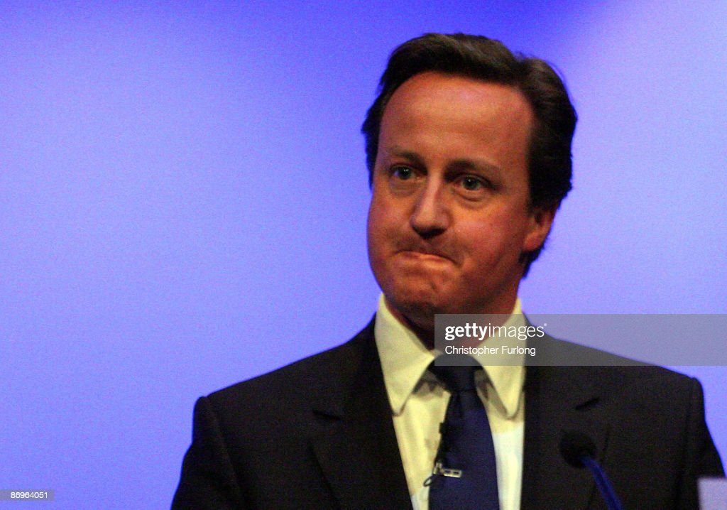Leader of Britain's Conservative party, <a gi-track='captionPersonalityLinkClicked' href=/galleries/search?phrase=David+Cameron+-+Politician&family=editorial&specificpeople=227076 ng-click='$event.stopPropagation()'>David Cameron</a>, gestures during his address to the Royal College of Nurses congress in Harrogate on May 11, 2009 in Harrogate, England. Cameron layed out his plans for the NHS and nurses to delegates. Prime Minister Gordon Brown earlier apologised on behalf of all parties for the mistakes on MP's expenses.
