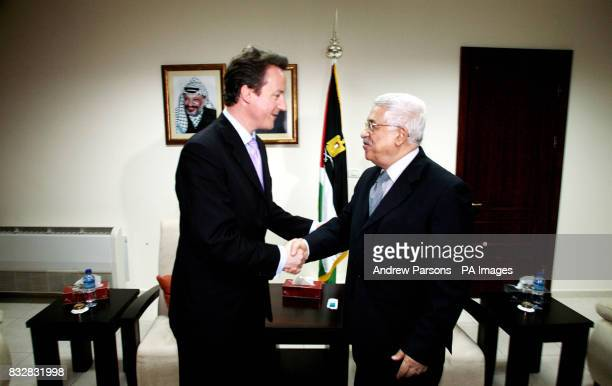 Leader of Britain's Conservative Party David Cameron meets Palestinian President Mahmoud Abbas at his residence in Ramallah Palestinian Territory on...