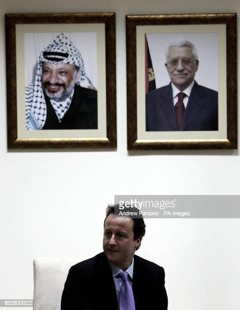 Leader of Britain's Conservative Party David Cameron meets with Palestinian President Mahmoud Abbas at his residence in Ramallah Palestinian...