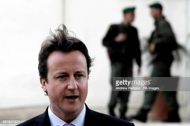 Leader of Britain's Conservative Party David Cameron talks to the press after meeting Palestinian President Mahmoud Abbas at his residence in...