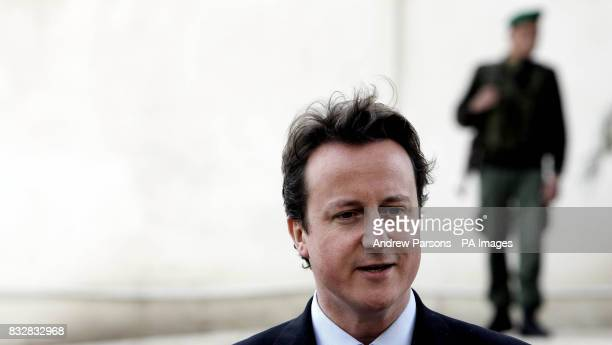 Leader of Britain's Conservative Party David Cameron talks to the press after meeting with Palestinian President Mahmoud Abbas at his residence in...