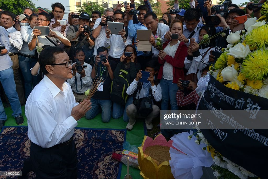 Leader of Cambodia National Rescue Party Sam Rainsy prays to mark the 11th anniversary of the death of labour leader Chea Vichea in Phnom Penh on...