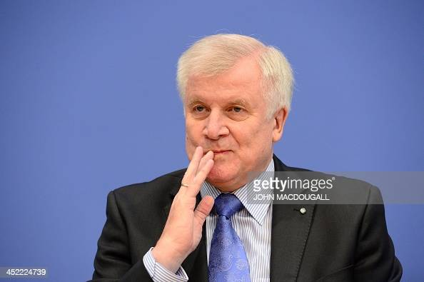 Leader of CDU Bavarian allies Christian Social Union Horst Seehofer gestures at a press conference after signing an agreement with Christian...