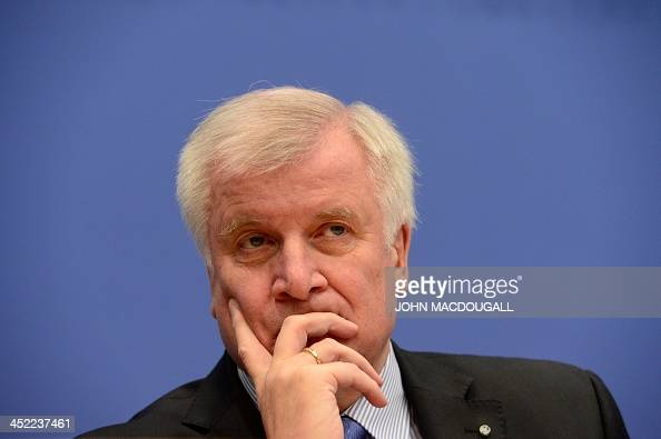 Leader of CDU Bavarian allies Christian Social Union Horst Seehofer is pictured at a press conference after signing an agreement with Christian...
