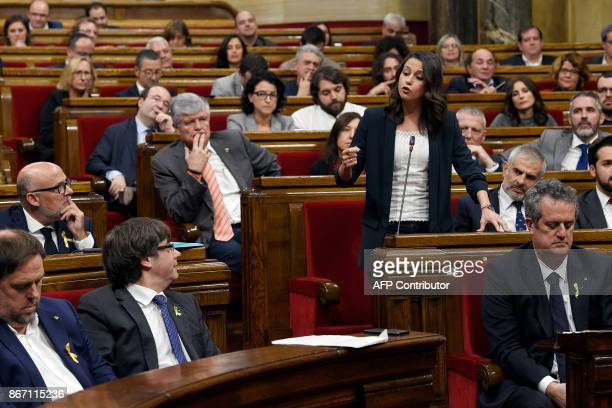 Leader of 'Ciutadans' in Catalonia Ines Arrimadas speaks to Catalan president Carles Puidgemont during a session of the Catalan parliament in...