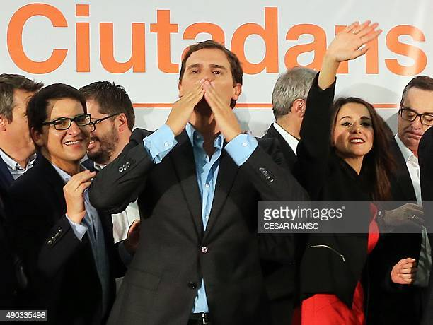 Leader of Ciutadans political party Albert Rivera blows a kiss next to candidate Ines Arrimadas as they celebrate following the results of the...