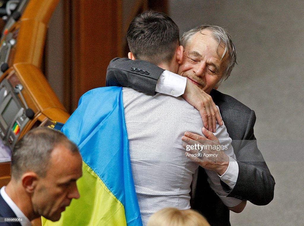 Leader of Crimean Tatars, Mustafa Dzhemilev (R) greets Ukrainian pilot and Ukrainian parliament member Nadiya Savchenko (L) during a session of Parliament, in Kiev, Ukraine on May 31, 2016.