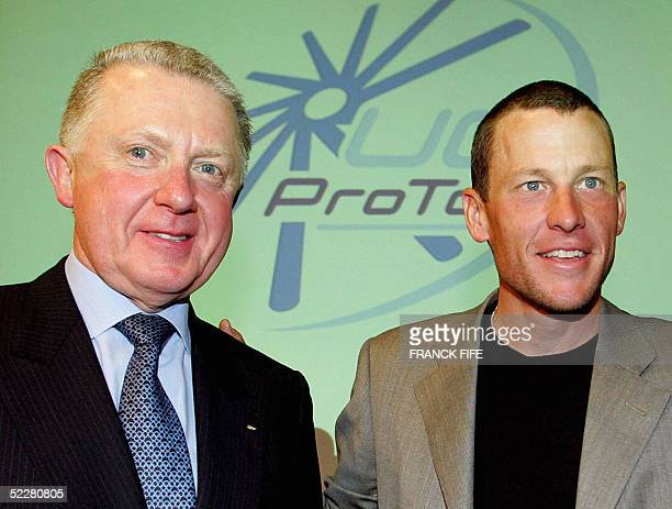 Leader of Discovery Channel team US Lance Armstrong poses with President of the International Cycling Union Hein Verbruggen 05 March 2003 n Paris...