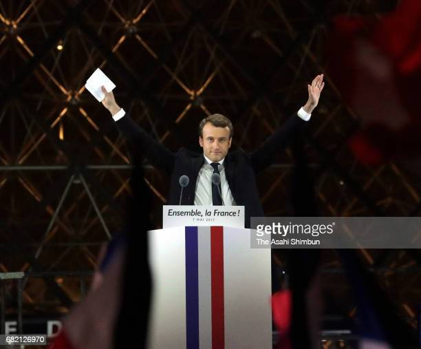 Leader of 'En Marche ' Emmanuel Macron waves to supporters after winning the French Presidential Election at The Louvre on May 7 2017 in Paris France...