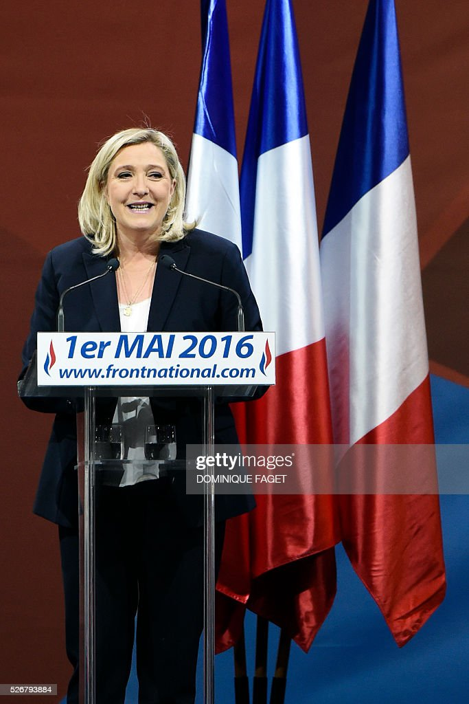 Leader of French far-right party Front National (FN) Marine Le Pen delivers a speech during a party lunch in Paris on May 1, 2016.