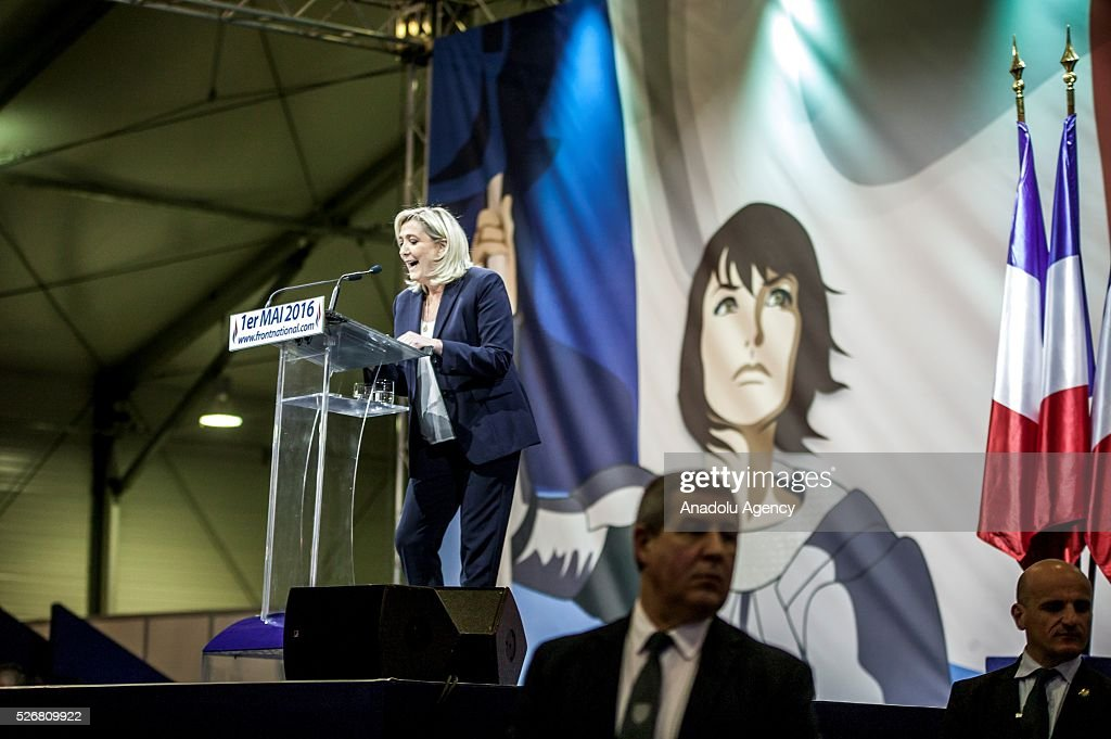 Leader of French far-right party Front National (FN) Marine Le Pen (C) gives a speech during the May Day party lunch at the Paris Event Center, in porte de la Villette, Paris, France on May 01, 2016.