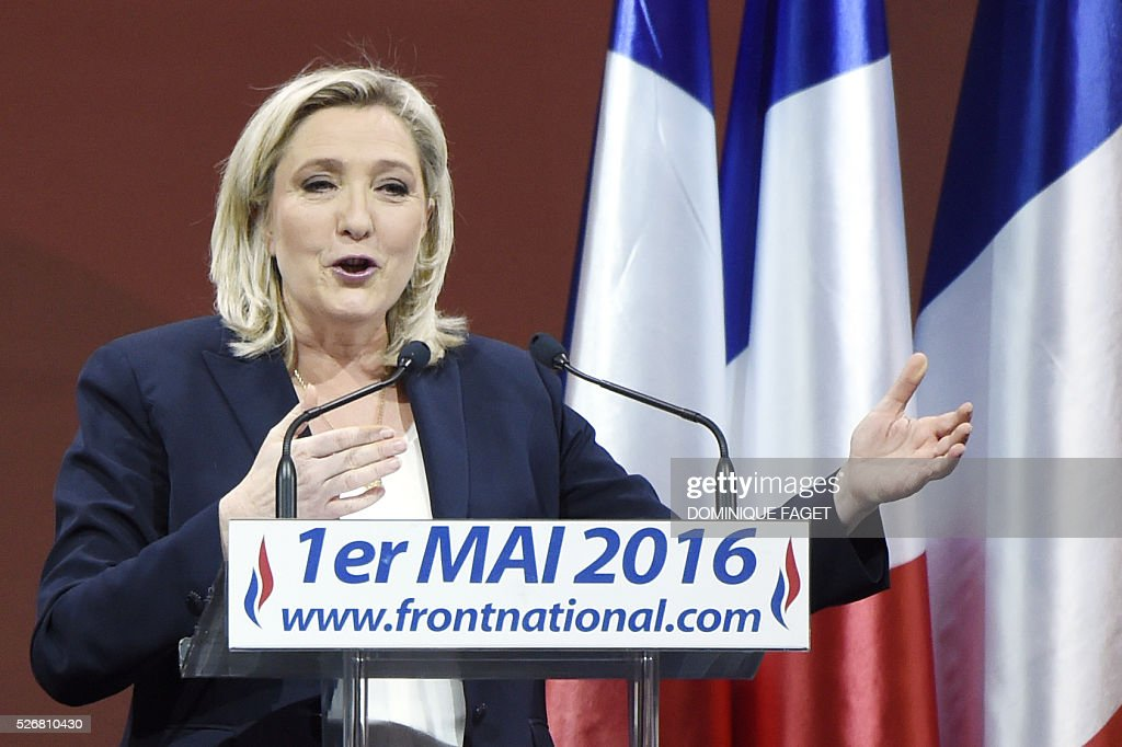 Leader of French far-right party Front National (FN) Marine Le Pen gives a speech during a party meeting on May 1, 2016 in Paris. / AFP / DOMINIQUE