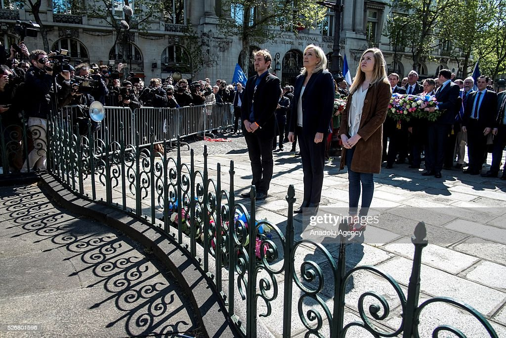 Leader of French far-right party Front National (FN) Marine Le Pen (2nd R) stand in one minute's silence as she takes part in the party's traditional May Day rally at the Jeanne d Arc statue in Saint Augustin Square in Paris, France on May 01, 2016