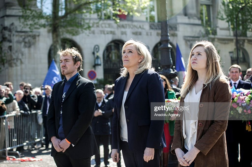 Leader of French far-right party Front National (FN) Marine Le Pen (C) takes part in the party's traditional May Day rally at the Jeanne d Arc statue in Saint Augustin Square in Paris, France on May 01, 2016