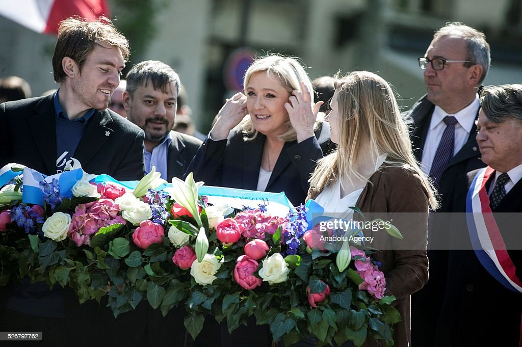 Leader of French far-right party Front National (FN) Marine Le Pen (3rd L) takes part in the party's traditional May Day rally at the Jeanne d Arc statue in Saint Augustin Square in Paris, France on May 01, 2016