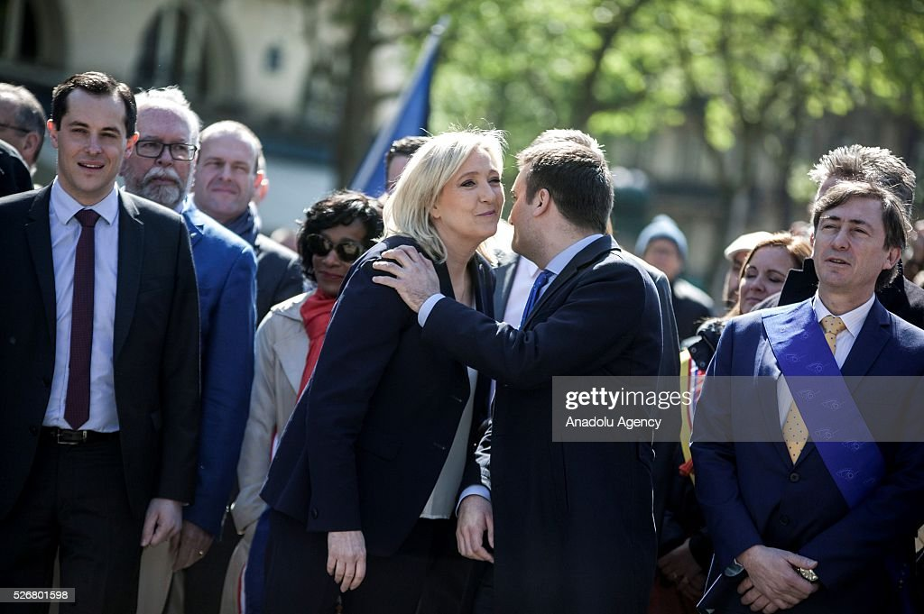 Leader of French far-right party Front National (FN) Marine Le Pen (3rd R) takes part in the party's traditional May Day rally at the Jeanne d Arc statue in Saint Augustin Square in Paris, France on May 01, 2016
